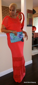 Orange & Lace Maxi dress with lacy orange shrug and blue floral clutch.